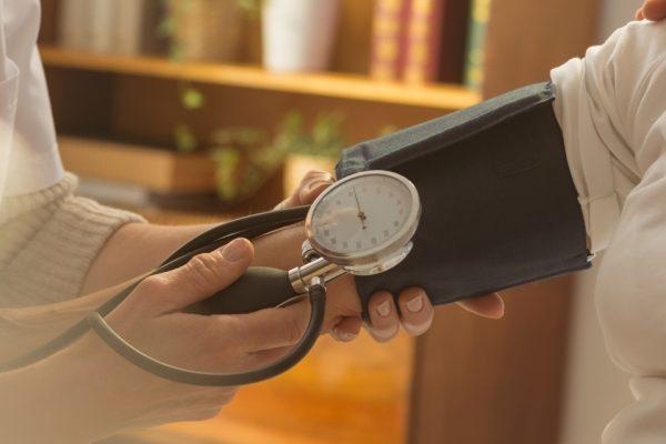 Older female patient when measuring pressure during home visit